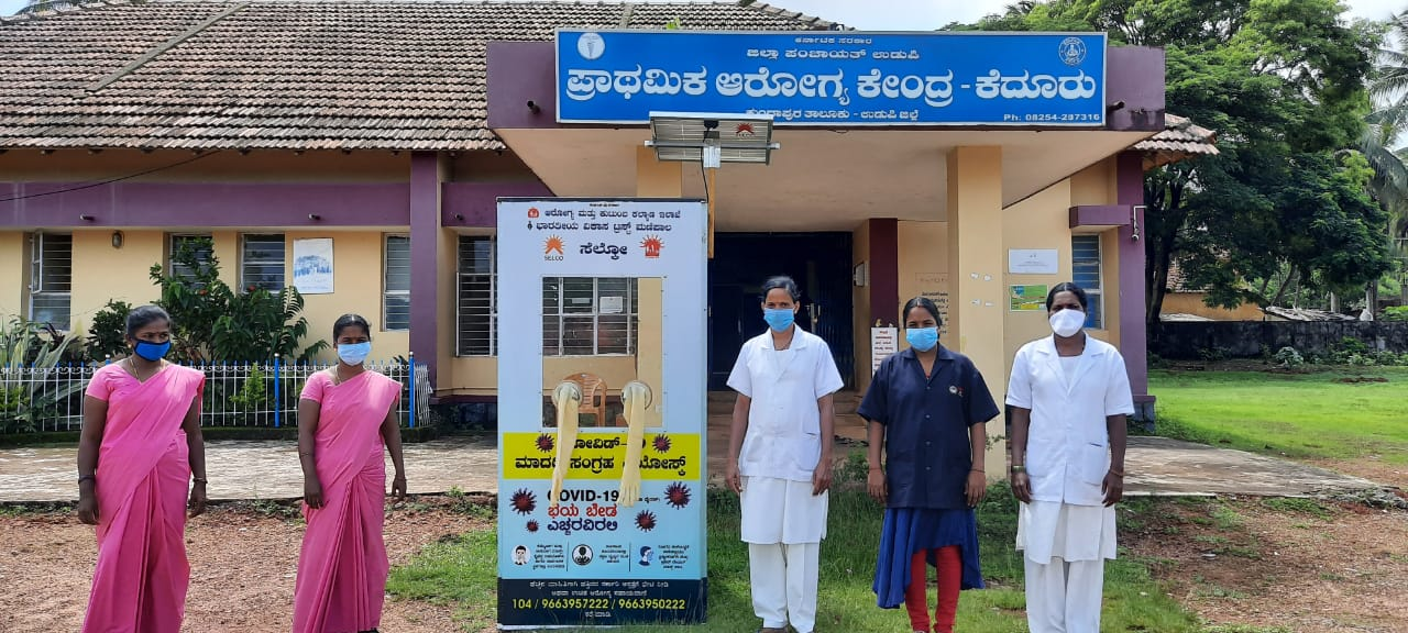 Staff of a primary healthcare centre in Udupi with the Solar-powered COVID-19 swab collection kiosk