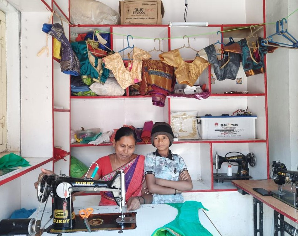 Rukmini has an unelectrified  Tailoring shop at  Dharwad