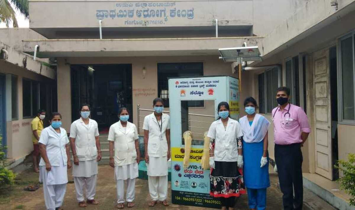 Staffs of a primary healthcare centre in Gangolli, Udupi with the Solar-powered COVID-19 swab collection kiosk